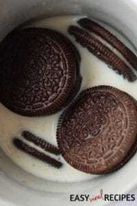 oreo cookies in a mug with milk