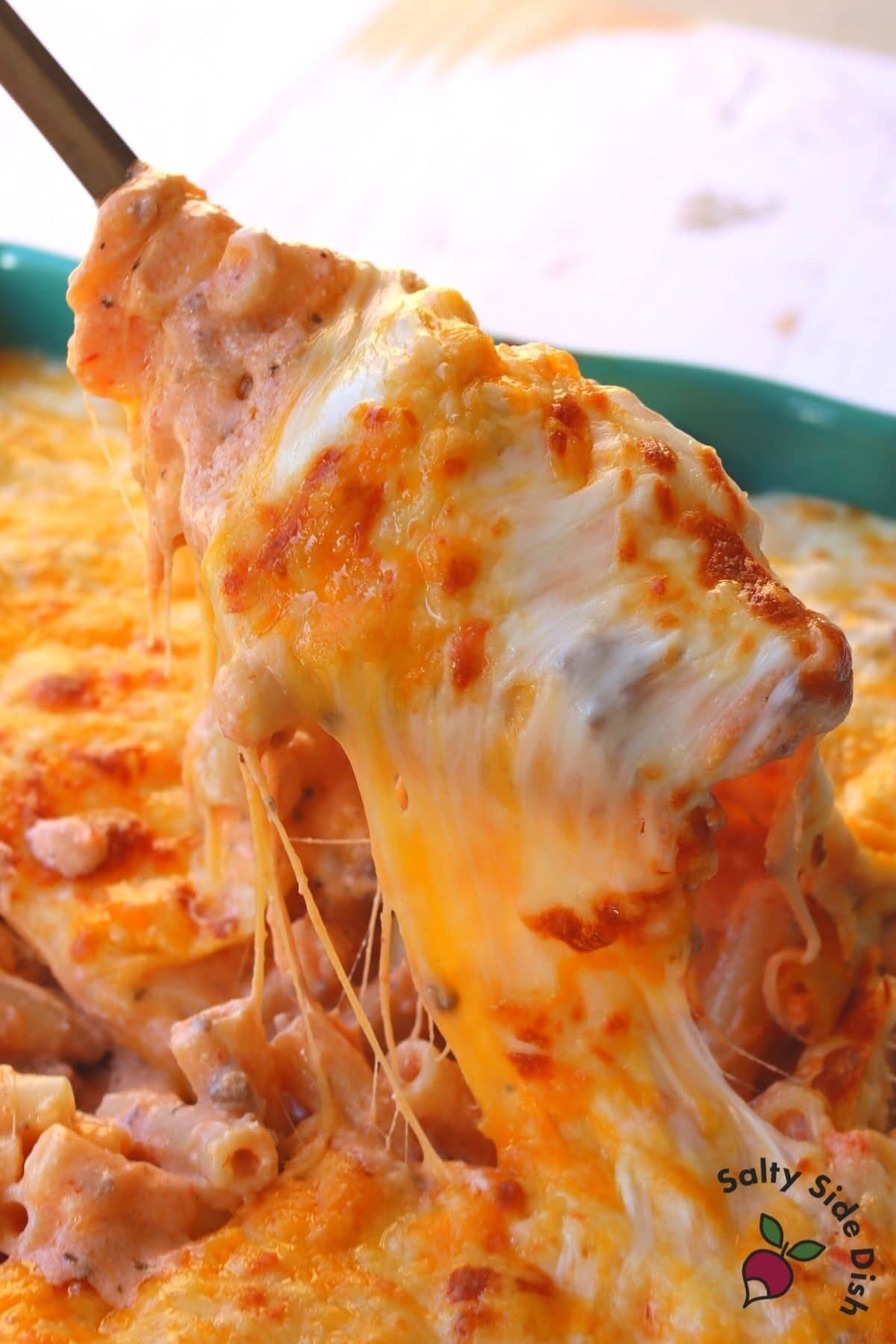 baked ziti with ricotta in a large spoon