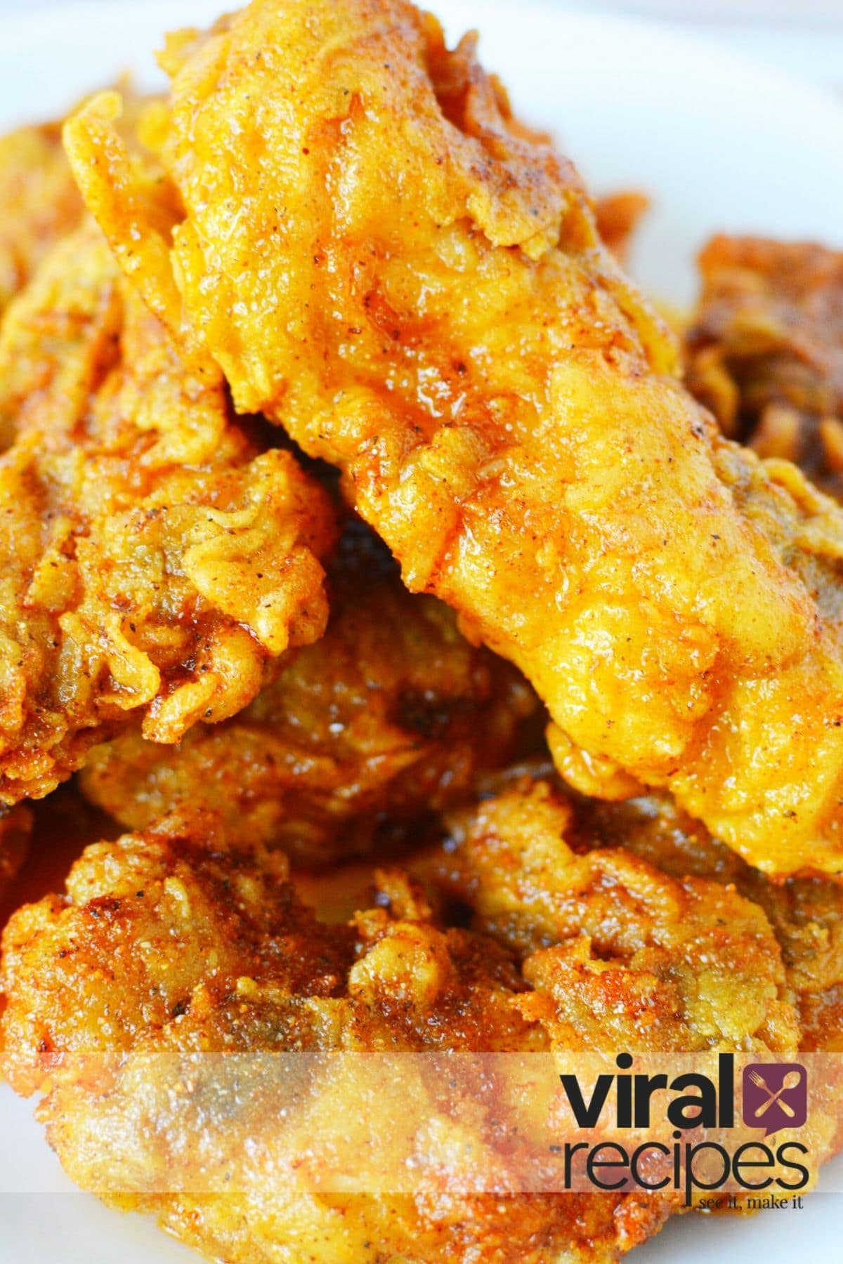 pile of hot chicken tenders on a plate.